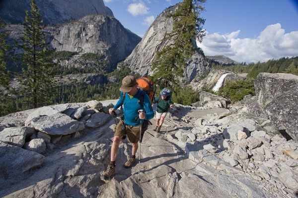Hikers enjoy the John Muir Trail near Nevada Falls and Liberty Cap in Yosemite National Park.