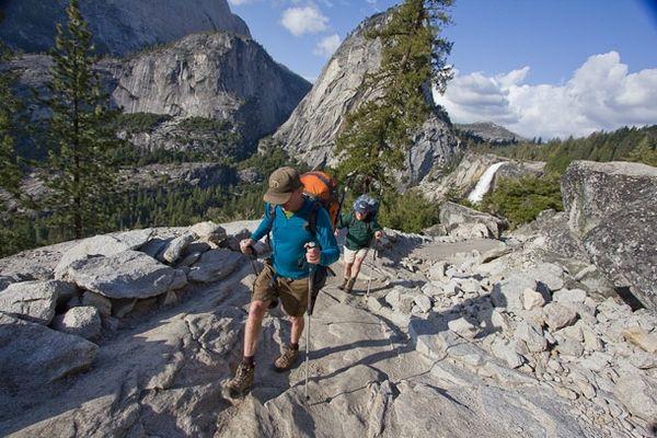 Hikers enjoy the John Muir Trail near Nevada Falls and Liberty Cap in Yosemite National Park.