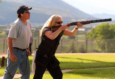 A man and woman skeet-shooting