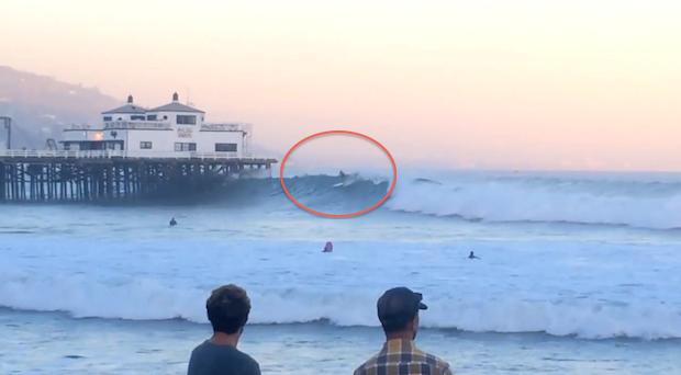 Laird Hamilton Surfs Through Malibu Pier On Giant Wave